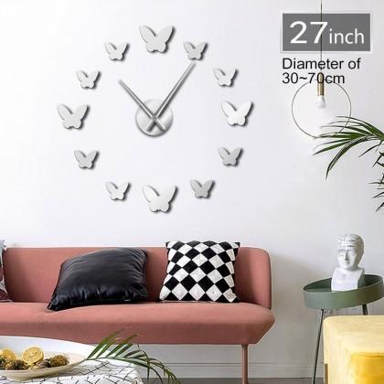 ساعة حائط لزقات لون فضي شكل فراشة