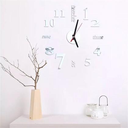 ساعة حائط لزقات لون فضي شكل كتابة و أرقام